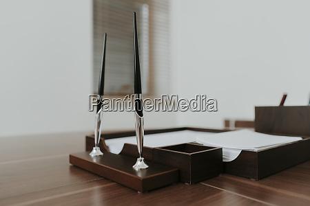 neat wooden desk in office