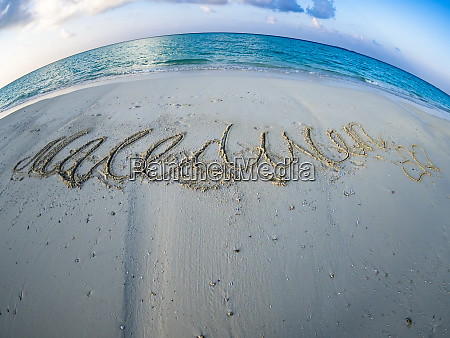 maledives ross atoll beach with writing