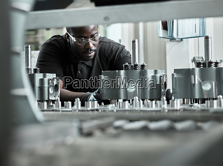 young man checking production line on