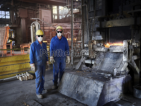 industry smeltery workers in front of