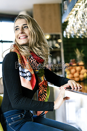 happy woman sitting at the counter
