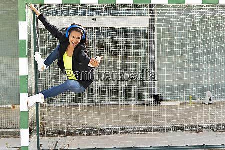 woman with blue headphones listening music