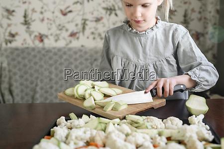 girl slicing vegetables