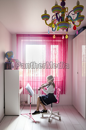 girl sitting at the window at