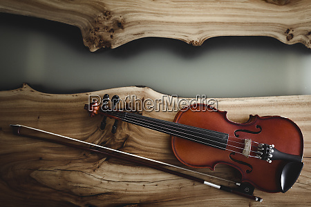 violin and bow on wood