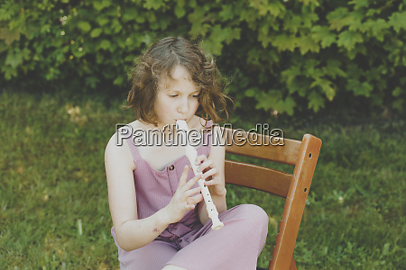 a girl playing the flute in
