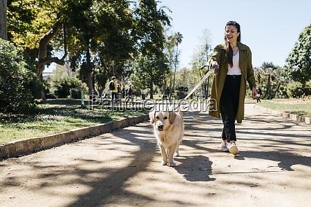 happy woman going walkies in city