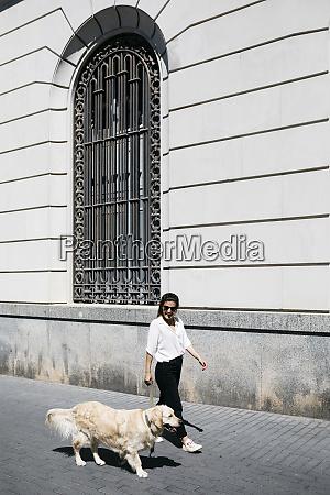 spain barcelona woman going walkies with