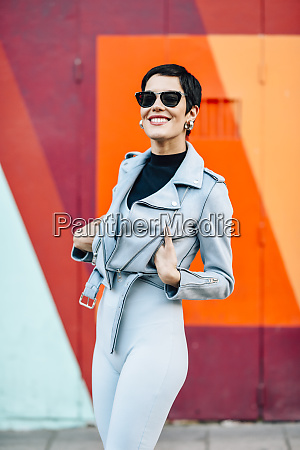 smiling fashionable young woman with colorful