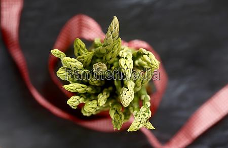 green asparagus red ribbon close up