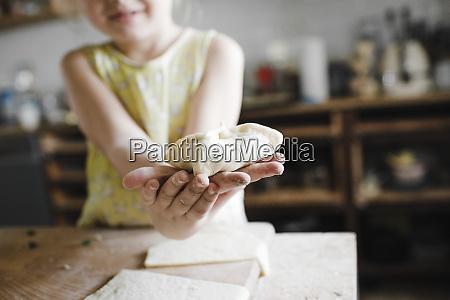 girls hands holding homemade stuffed pastry