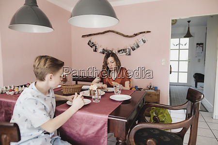 mother and son sitting at dining