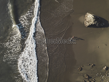 family at the beach aerial view