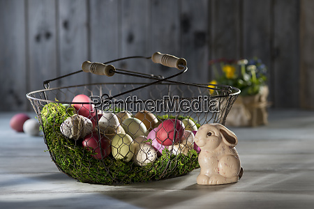 easter eggs in wire basket with