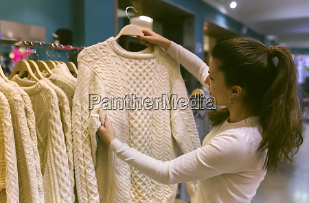 woman holding a pullover in a