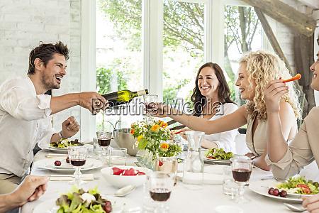 hapuepy family celebrating together drinking wine