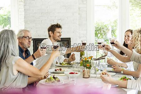 hapuepy family celebrating together clinking glasses