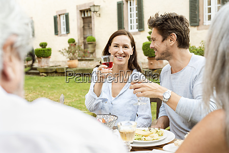 happy family eating together in the