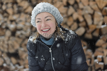 portrait of happy woman in snowfall