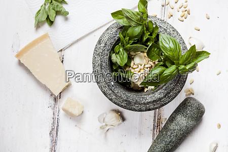 preparing pesto alla genovese with mortar