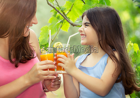happy family drinking juice