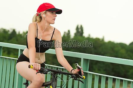 female biker with earphones