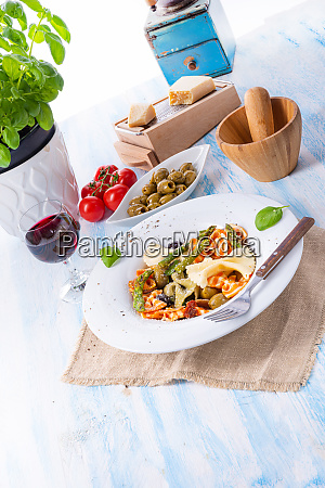 colorful farfalle with green asparagus olives