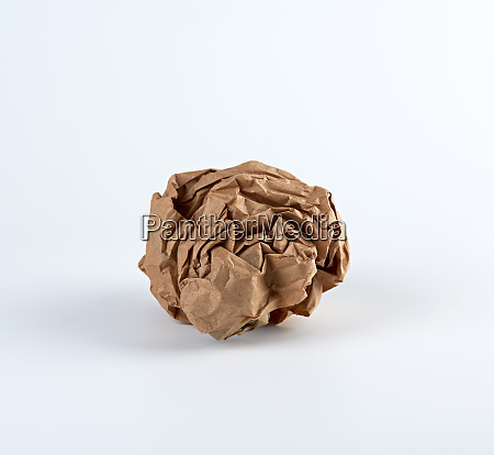 crumpled sheet of brown paper on