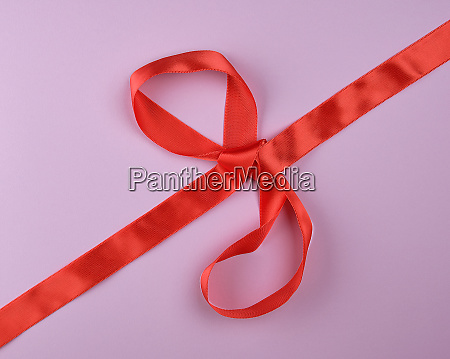 red silk ribbon tied in a