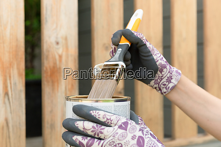 womans hand with a paintbrush painting