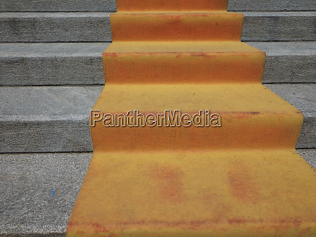 orange red carpet on stairway