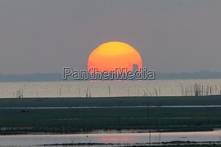 the large sunrise is orange sunrise