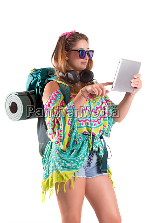 traveling girl with backpack and tablet