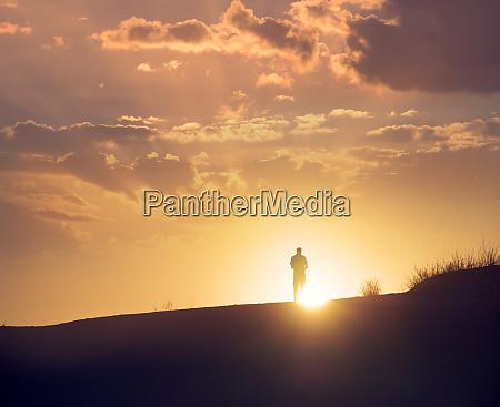 traveller enjoys sunset at white sands