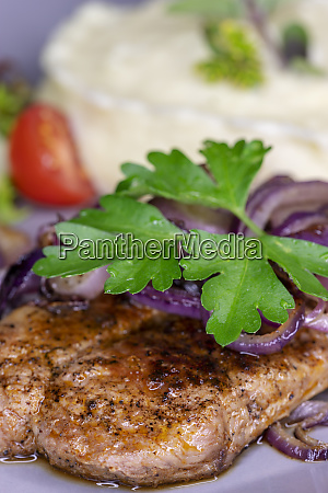grilled pork steak with onions