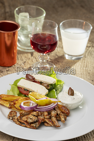greek gyros on a plate with