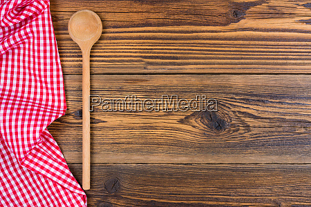 an old wooden spoon and a