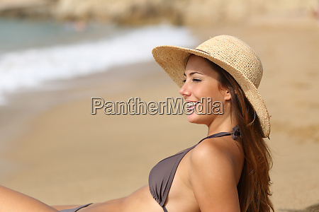 beauty sunbather contemplating ocean on the