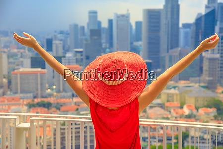 a woman enjoys panorama of singapores
