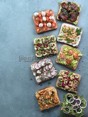 assortment vegan sandwiches on gray stone