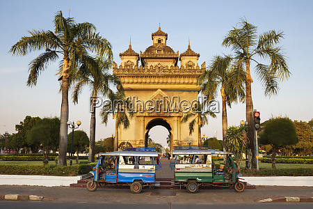 tuk tuks parked in front of