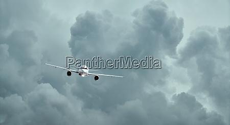 flight of the plane in cumulus