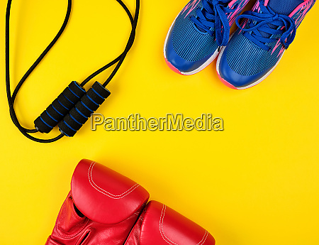 pair of blue sneakers red leather