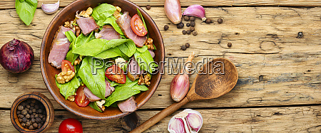 salad with meat spinach and sorrel