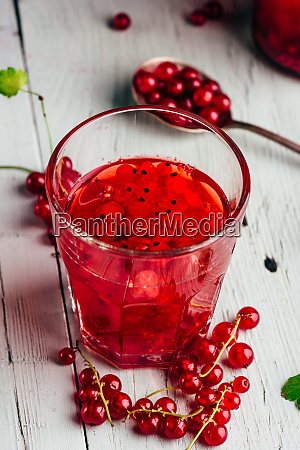 glass of infused water with red