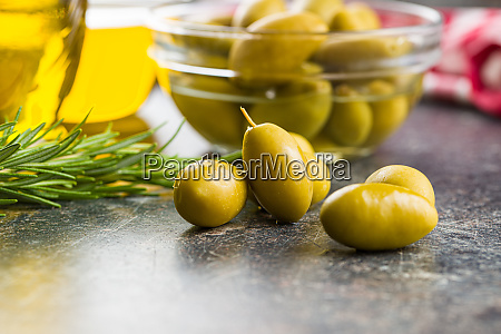 green olives on old kitchen table