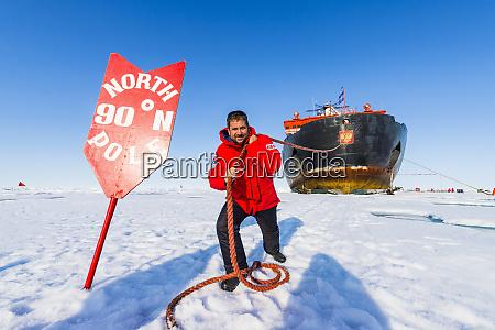 man pretending to pull the icebreaker