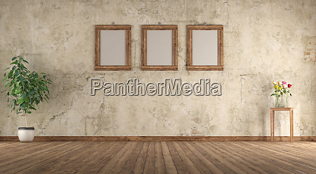old empty room with wooden picture