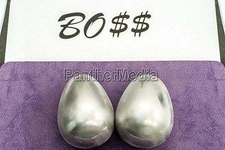 two metal eggs on the office