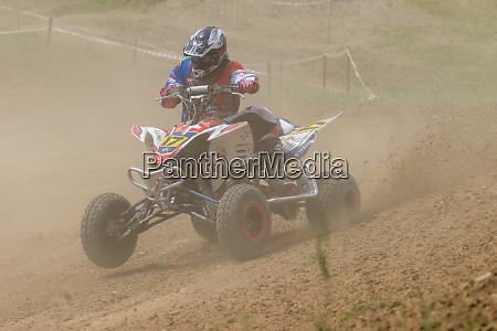 young rider on a quad bike